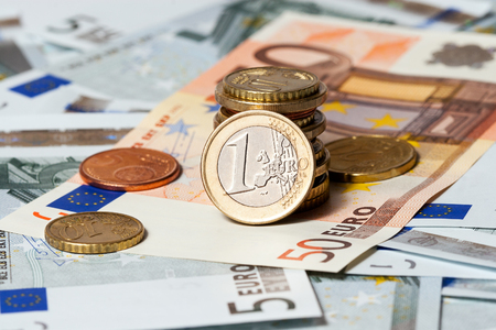 The European currency: banknotes of five euros and coins