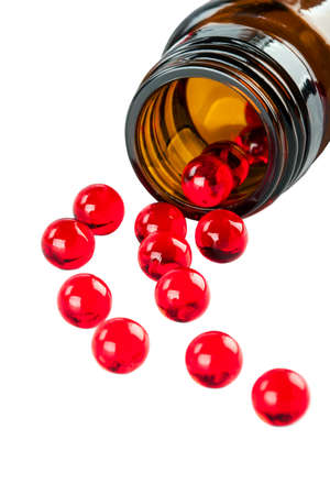 Red capsules on a white background Stock Photo