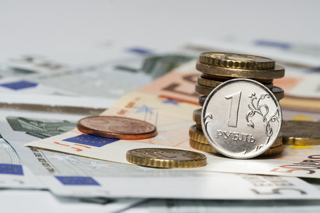 coin one ruble and the European currency  banknotes of five and fifty euro coins Stock Photo