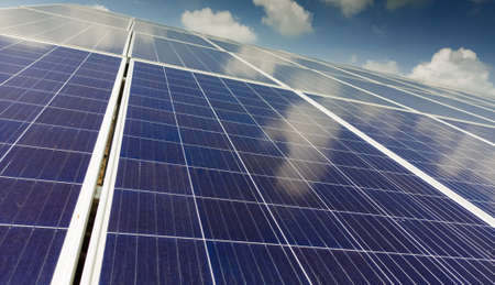 Close up view of installed solar panels or modules and clear sky, sunny day.