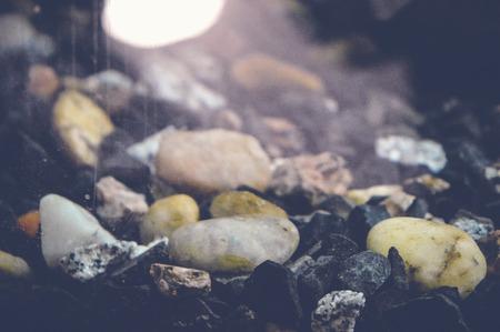 fishtank: Stones in fishbowl background Stock Photo