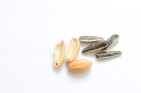 sunflower seeds: peanuts and sunflower seeds isolated on white