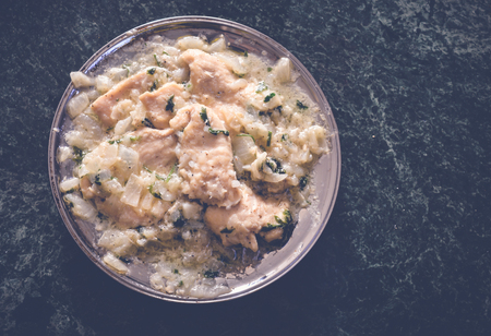 suppertime: top view of chicken with lemon sauce with copy space Stock Photo
