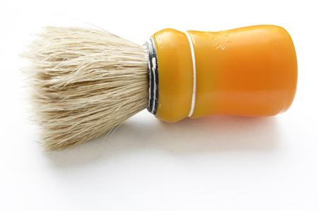 orange shaving brush isolated on white