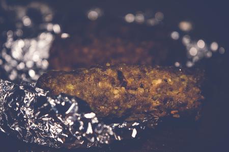 aluminium: kofta kebabs on aluminum foil paper, selective focus