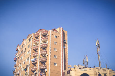 weathered: high old building with view of sky at cairo, egypt