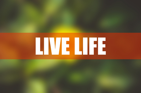 LIVE LIFE word with blurred flower background