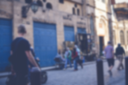 blurred background of people walking in the street Stock Photo