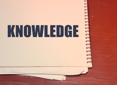 knowledge written on white paper, business concept background
