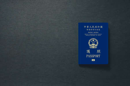 Hong Kong Passport on dark background with copy space - 3D Illustration