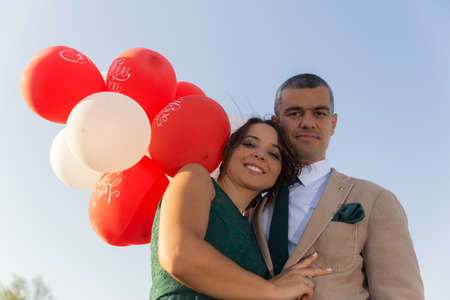 love at first sight: Young couple with red and white love baloons Stock Photo