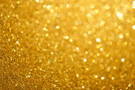Golden Defocused Christmas background from small to big spots
