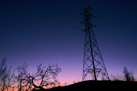 High Voltage tower at dusk Stock Photo