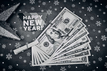 American banknotes and Christmas background in black and white