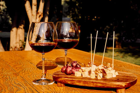 Glasses Of Fine Red Wine With Grape and cheese