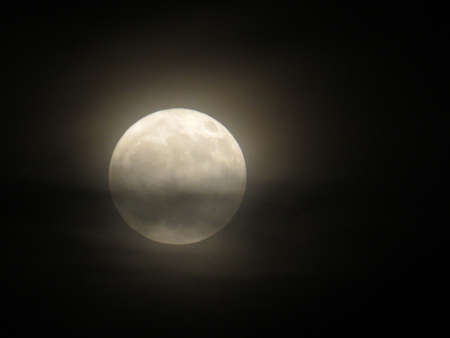 Full moon behind the clouds Stock Photo