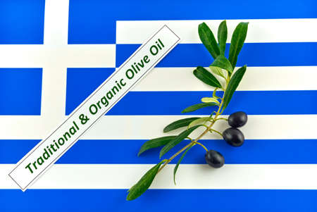 Olive branch with olives onto Greece flag Standard-Bild