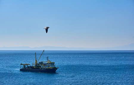 Trawl fishing boat near plan shot Stock Photo