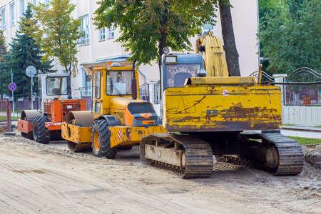 paver: road repair, road machinery, paver and excavator