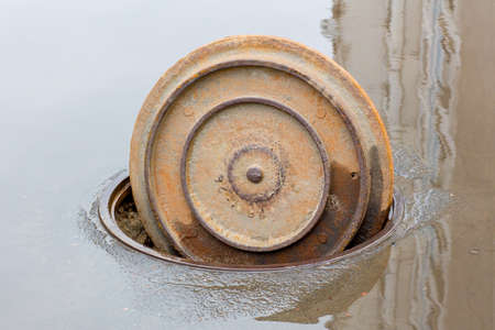 open manhole cover of a sewer