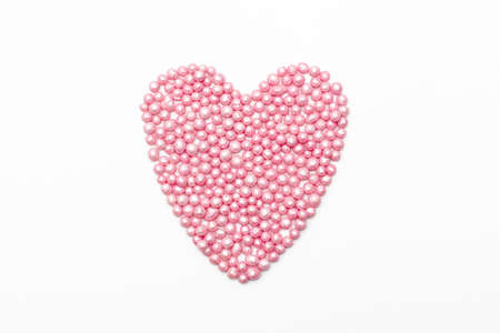 heartshaped: pink heart sprinkles on a white background. romantic love background for Valentines day, birthday, holiday, party, wedding.