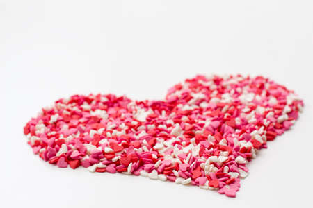 heart made of many little hearts white pink and red. festive background for Valentines day, birthdays, holiday