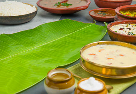 Kerala traditional feast side dishes arranged in grey colour background Reklamní fotografie