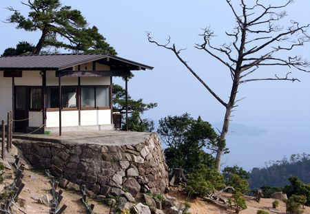 feudalism: Building on top of the mountain in the Miyajima island. Japan Stock Photo