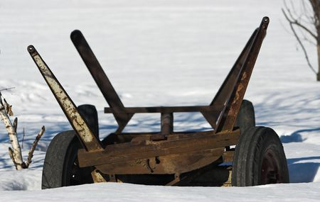 Trailer left in the snow. Picture taken in the countryside in Poland photo