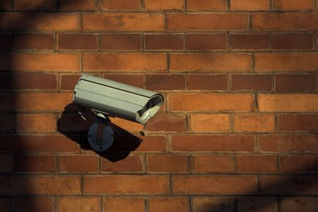 bank records: CCTV on the brick wall of the bank building