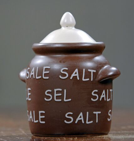 Brown retro-style salt cellar on the table photo