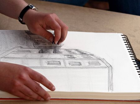 outline drawing: Girl sketching a building. Picture taken in Porto  Portugal.