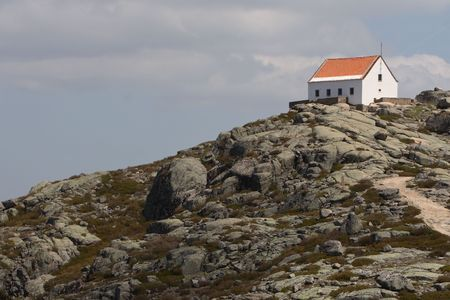 alpine hut: House on the top of the mountain. Pictue taken in Serra de Estrela mountains in Portugal