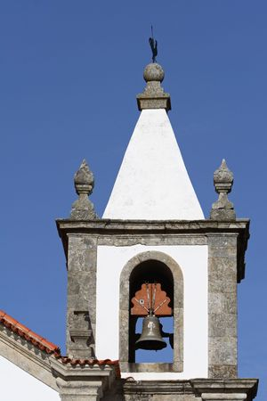 Belfry of the old, white church. Picture taken in Portugal photo