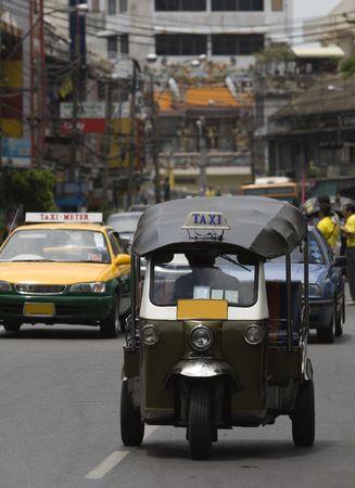 Tuk-tuk (cab) speeding on the street. Picture taken in Bangkok / Thailand Stock Photo - 919028