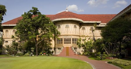 teakwood: Vimanmek - Dusit Palace. The words largest golden teakwood mansion. Royal palace in Bangkok Stock Photo