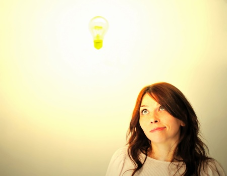 Beautiful young woman with bright idea. photo