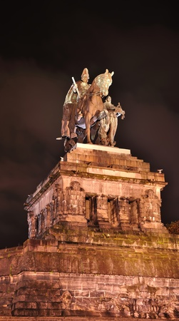 confluence: Statue of imperator Wilhelm at the Deutsches Eck in Koblenz at night Stock Photo