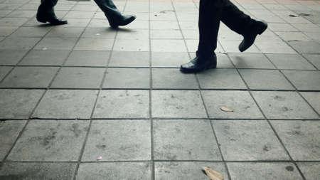 man: Walking on the footpath Stock Photo
