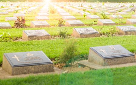 Kanchanaburi, Thailand - August 21, 2016: Row of tombs, World War II Cemetery at Kanchanaburi province,Thailand. Effect with lens flare.