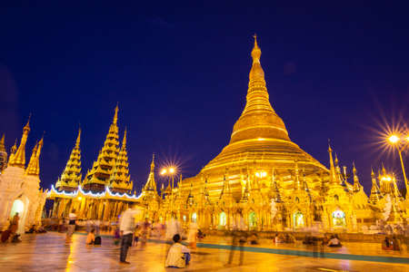 YANGON, MYANMAR - MAY 17, 2018 : Shwedagon Pagoda at night ,Yangon, Myanmar. Low speed shutter.