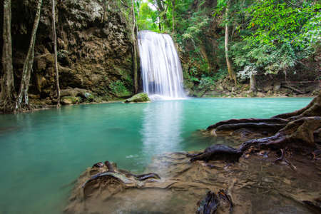 Erawan Falls (The third waterfall – Pha Nam Tok) with emerald green pond in Erawan National Park. Kanchanaburi Province, Thailand.