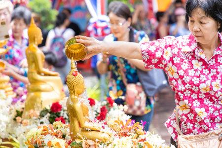 BANGKOK, THAILAND - April 15, 2019: People bathing rite to buddha images at Wat Pho. Song