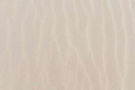 Yellow sand with waves on beach Stock Photo