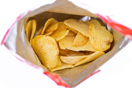 Potato chips in bag on white background.