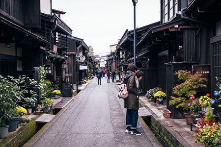 Takayama, Japan - October 21,  2019 : Tourists visiting the Old City of Takayama, Japan Editorial