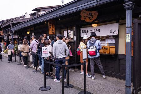 Takayama, Japan - October 21,  2019 : People queue to buy famous Hida beef Sushi in Takayama old town, Japan.