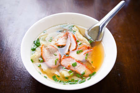 Wonton soup with red roasted pork. Selective focus.