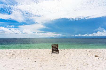Wooden beach chair on white sand beach in Thailand. Reklamní fotografie