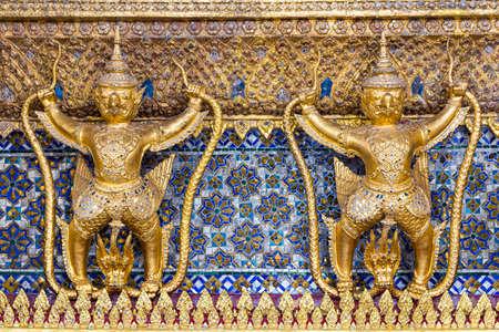 Golden statue of Garuda (a mythical half man and bird) at Wat Phra Kaew, Bangkok< thailand.